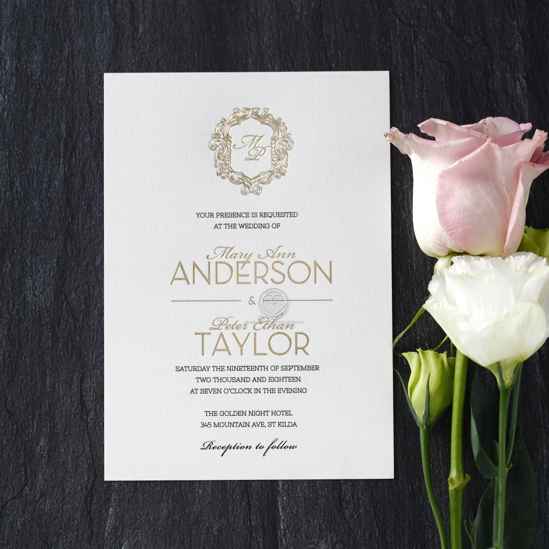 classic formal invitation with gold monogram foil printing