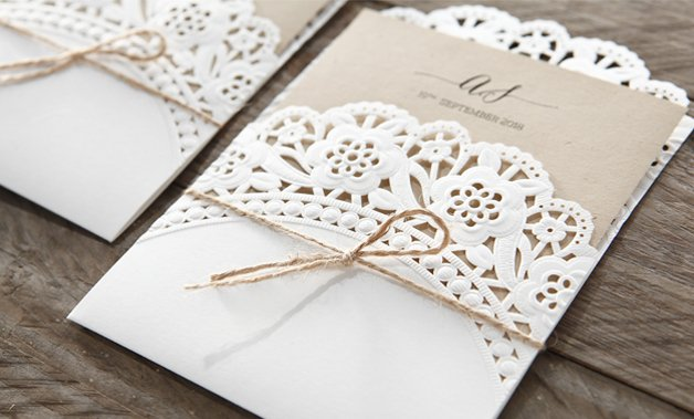 Wedding invitations laser cut invites stationery cards online brown craft card printed in black ink enclosed in a charming floral patterned laser cut filmwisefo